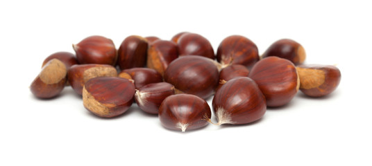 sweet chestnuts isolated on white