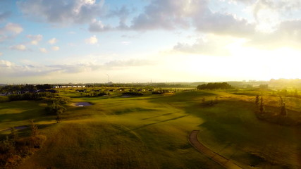 Sunset at golf course, aerial footage