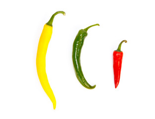 Three peppers in a row in different colors