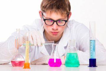 Student man in chemistry lab doing reactions