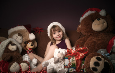 beautiful girl with a New Year's gift and soft toys