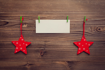 empty greeting card between xmas stars