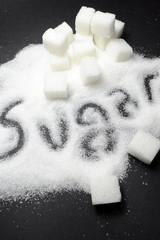 Sugar on black background close up