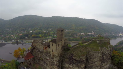 Flying around medieval castle, city dam, old fortress on river