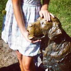 Girl dog monument friend