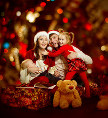 Christmas family of four persons happy smiling
