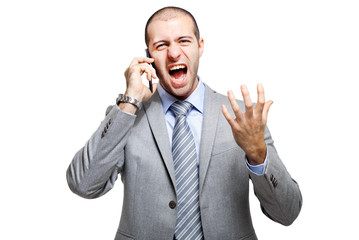 Angry business man screaming on mobile phone