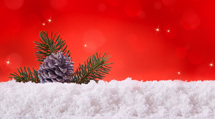 Red christmas background and fir cones.