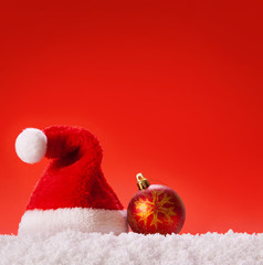 Santa hat  and white snow on red background.