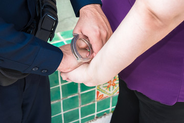 Under Arrest Police Officer Handcuffing Criminal Suspect