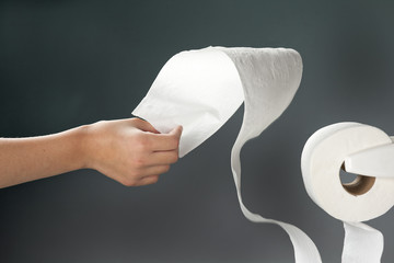 Yanking the toilet paper.