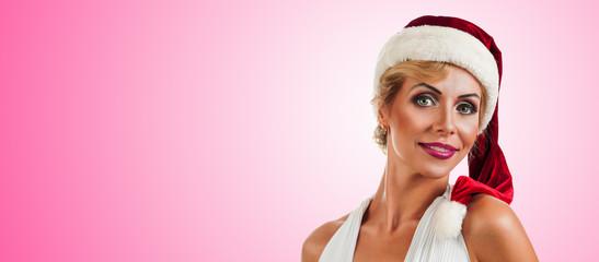 Portrait beautiful woman wearing a santa hat