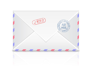 Air mail envelope with postal stamp isolated on white background
