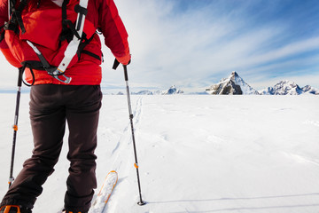 Mountaineer exploring a glacier with the skis during a high-alti