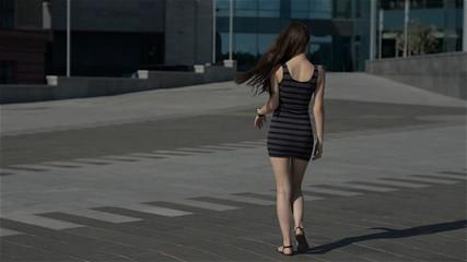 happy beautiful girl walking down the street