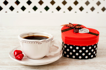 Valentine's day celebration cup of coffee with heart shaped gift