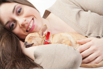 young beautiful woman loving her puppy
