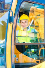 Asian shovel excavator driver on construction site