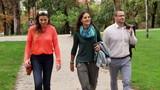 Happy friends walking in the park, steadycam shot