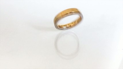 wedding ring, spinning on a white background in slow motion.