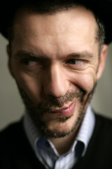 Strange funny face in great DOF of a funny man with beard and a