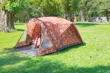 camping tent on green grass field of forest national park