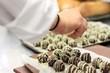 chef making chocolate truffles - 73332657