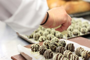 chef making chocolate truffles