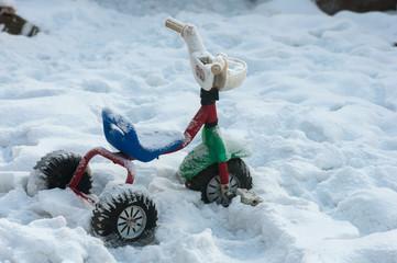 Children's bike in the snow