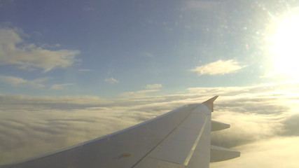 View Of Wing In Sky Out From Flying Airplane