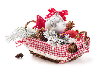 Basket of Christmas decorations and gifts isolated on white back