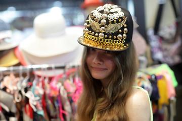 Girl at shop hats