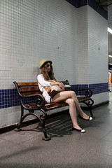 Girl on the bench in subway station