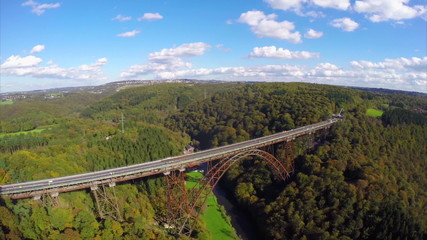 Beautiful landscape above old steel railroad train bridge aerial
