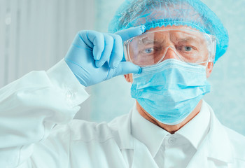 Portrait of senior man surgeon