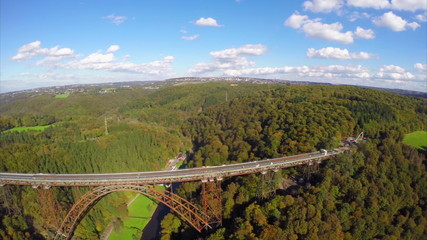 Flying along side old steel bridge, railroad train road aerial
