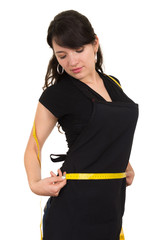 beautiful slim fit young girl holding measuring tape around her