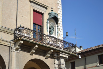 Balcony of old medieval building on Piazza Cavour