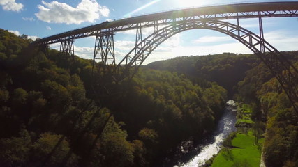 High huge bridge silhouette in sunlight aerial shot, railroad
