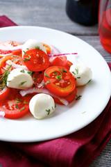 Tasty vegetable salad with mozzarella