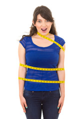 young girl with measuring tape around her body