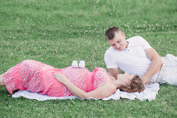 Man and Pregnant Woman in the Park
