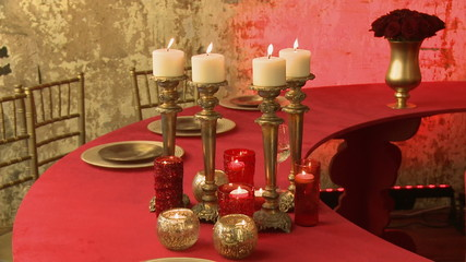 View of served table in red and golden tones