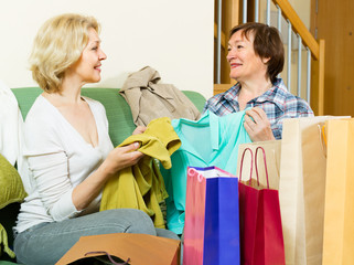 Two women with shopping bags