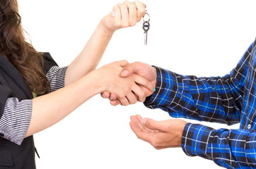 closeup hands handing over key concept of buying deal sale