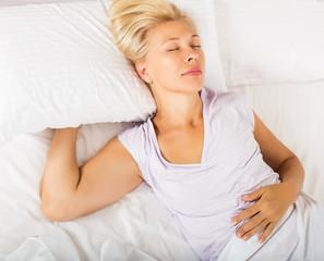 Mature female in pajamas sleeping