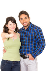 attractive young happy couple hugging and holding key