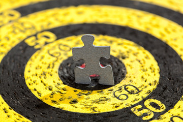 Jigsaw Puzzle Piece on Yellow Old Target