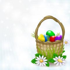 Basket full of easter eggs on a light background
