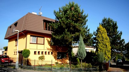 exterior house in the city - urban street - nature (trees)